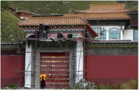 Surmang Khenpo in front of the shedra main gate