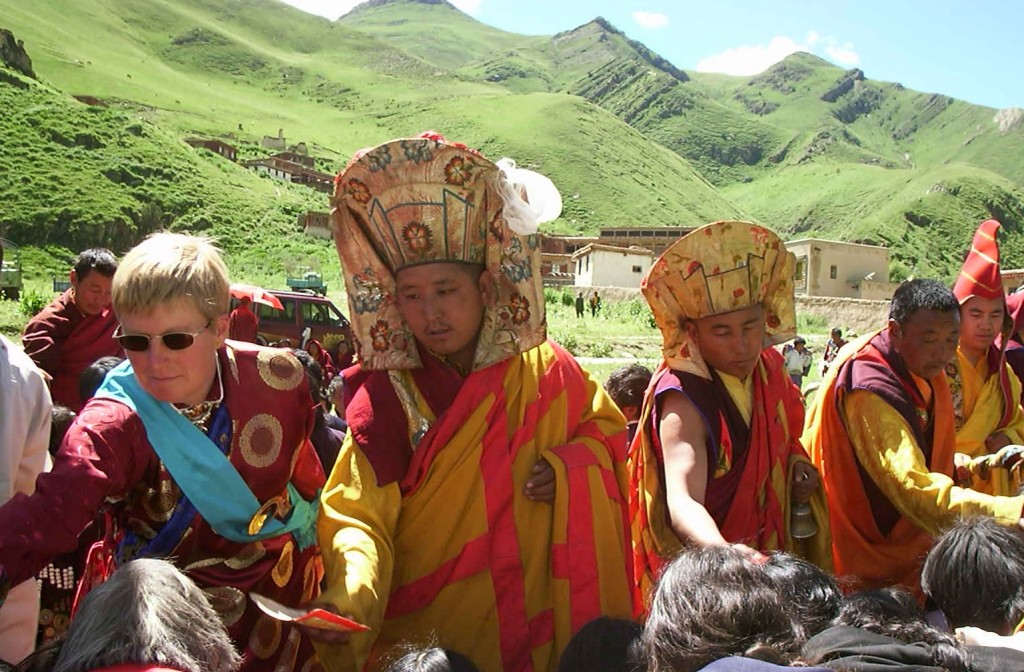 Lady Diana Mukpo in blessing line with Surmang leaders