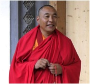 Karma Senge Rinpoche in front of the main door of the shedra lhakang