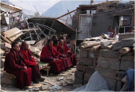 Trungpa XII Rinpoche, Aten Rinpoche and Surmang monks engage in Buddhist practices for those who died at this location-the bodies of the deceased are contained within the block enclosure April 2010